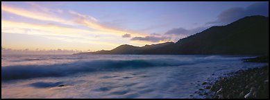 Wave and coastal hills at dawn, Tutuila Island. National Park of American Samoa (Panoramic color)