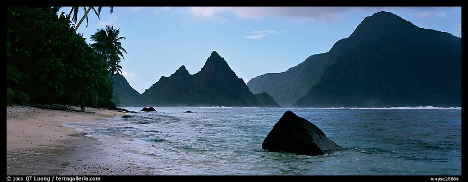Tropical peaks raising abruptly above beach, Ofu Island. National Park of American Samoa (color)
