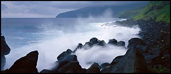 Shoreline with black rock pounded by strong surf, Tau Island. National Park of American Samoa (Panoramic color)