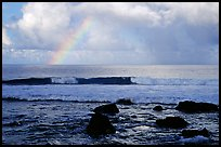 Rainbow and boulders, Siu Point, Tau Island. National Park of American Samoa