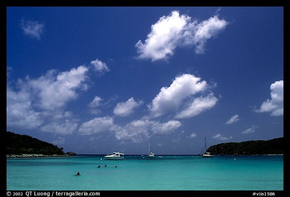 Saltpond bay beach with swimmers and boats. Virgin Islands National Park, US Virgin Islands.