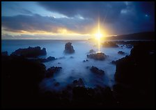 Sun shining brilliantly over primeval seascape, Kenae Peninsula. Maui, Hawaii, USA