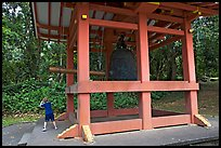 Boy ringing the buddhist bell, Byodo-In temple. Oahu island, Hawaii, USA