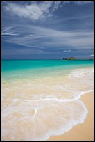 Foam, sand, and turquoise waters, Waimanalo Beach. Oahu island, Hawaii, USA (color)