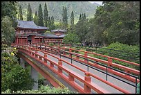 Red bridge leading to Byodo-In Temple. Oahu island, Hawaii, USA