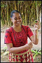 Tonga woman showing how to make cloth out of Mulberry bark. Polynesian Cultural Center, Oahu island, Hawaii, USA ( color)