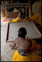 Fiji women playing a traditional game similar to pool. Polynesian Cultural Center, Oahu island, Hawaii, USA ( color)