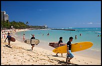 Men walking on Waikiki Beach with surfboards. Waikiki, Honolulu, Oahu island, Hawaii, USA (color)