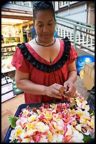 Woman preparing a fresh flower lei, International Marketplace. Waikiki, Honolulu, Oahu island, Hawaii, USA