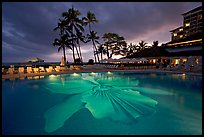 Swimming pool at sunset, Halekulani hotel. Waikiki, Honolulu, Oahu island, Hawaii, USA ( color)