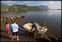Fisherman with family and small baot, Kaneohe Bay, morning. Oahu island, Hawaii, USA ( color)