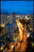 Boulevard and high rise buildings at dusk. Waikiki, Honolulu, Oahu island, Hawaii, USA ( color)