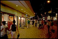 Shops on Kalakaua avenue at night. Waikiki, Honolulu, Oahu island, Hawaii, USA (color)