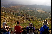 Tourists look at the  Diamond Head crater, early morning. Oahu island, Hawaii, USA ( color)