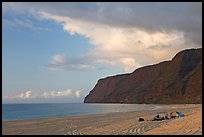 Campers and tire tracks in the sand, Polihale Beach, sunset. Kauai island, Hawaii, USA ( color)