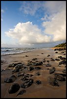 Boulders, coastline, and clouds, Lydgate Park, sunrise. Kauai island, Hawaii, USA