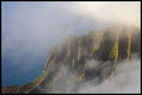 Fluted ridges seen through clouds, Kalalau lookout, late afternoon. Kauai island, Hawaii, USA ( color)