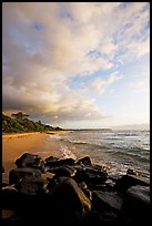 Boulders and beach, Lydgate Park, sunrise. Kauai island, Hawaii, USA ( color)