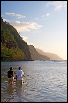 Couple looking at the Na Pali Coast, Kee Beach, late afternoon. Kauai island, Hawaii, USA ( color)