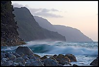 Boulders, waves, and Na Pali Coast, sunset. North shore, Kauai island, Hawaii, USA