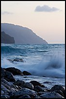Boulders, waves, and Na Pali cliffs, sunset. Kauai island, Hawaii, USA ( color)