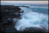 Surf and lava shoreline at sunset, South Point. Big Island, Hawaii, USA