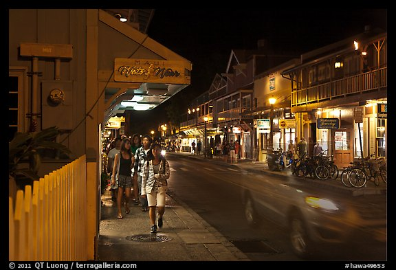 Tourists strolling store-lined street at night. Lahaina, Maui, Hawaii, USA (color)