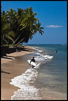 Surfer walking on beach. Lahaina, Maui, Hawaii, USA (color)