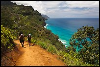 Hikers on Kalalau trail, Na Pali coast. Kauai island, Hawaii, USA ( color)