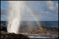 Spouting Horn with rainbow, late afternoon. Kauai island, Hawaii, USA (color)