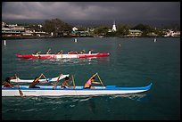 Outrigger canoes and town under storm sky, Kailua-Kona. Hawaii, USA ( color)