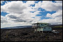 House built over fresh lava fields. Big Island, Hawaii, USA (color)