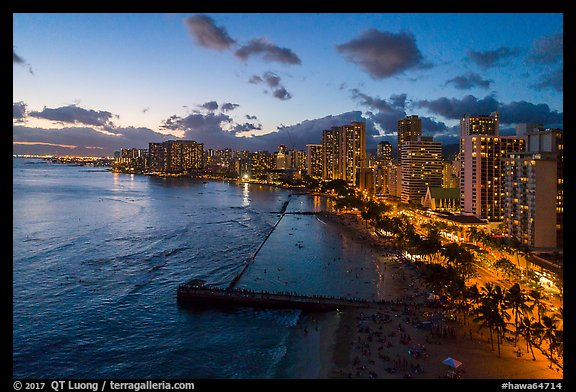 Aerial view of Kuhio Beach, skyline at dusk. Honolulu, Oahu island, Hawaii, USA (color)