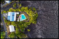 Aerial view of house and pool on edge of lava field. Big Island, Hawaii, USA ( color)