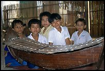 Boys with a traditional musical instrument. Phnom Penh, Cambodia (color)