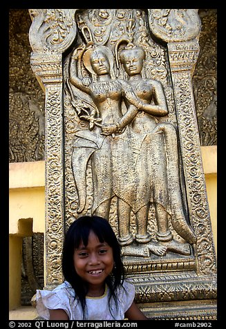 Girl and sculpture at Wat Phnom. Phnom Penh, Cambodia