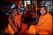 Buddhist novice monks inside temple. Luang Prabang, Laos (color)