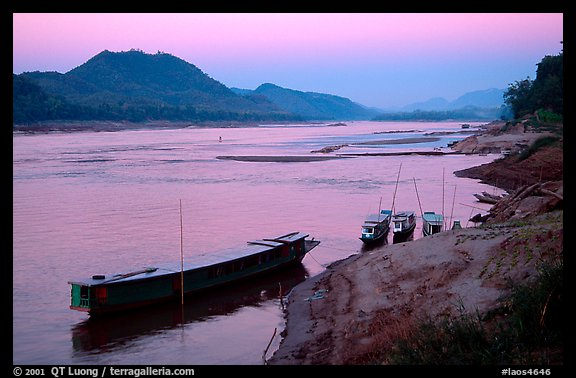 Dusk on the Mekong river framed by coconut trees. Luang Prabang, Laos (color)