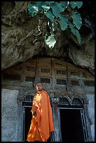Novice Buddhist monk at entrance of lower Pak Ou cave. Laos ( color)