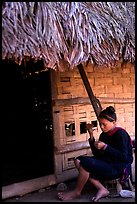 Woman of the Lao Huay tribe in front of her hut,  Ban Nam Sang village. Laos ( color)