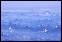 View from the hill through dawn mist. Mandalay, Myanmar ( color)