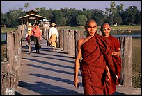 On the two century old U Bein bridge. Amarapura, Myanmar ( color)