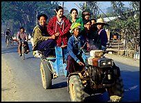 Riding tractor on road near Swwenyaung. Shan state, Myanmar ( color)