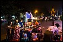 Streat food served at night, Shwedagon Pagoda in background. Yangon, Myanmar ( color)