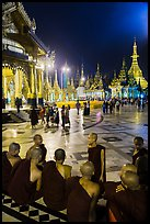 Monks, Terrace and Naungdawgyi (Elder Brother) Pagoda at night, Shwedagon Pagoda. Yangon, Myanmar ( color)