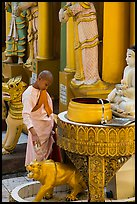 Nun pouring water at planetary post. Yangon, Myanmar ( color)