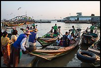 Passengers on oared water taxi crossing Yangon River. Yangon, Myanmar ( color)