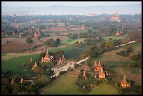 Aerial view of many temples set amongst fields. Bagan, Myanmar ( color)