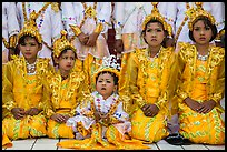 Girls and boy dressed in glittering clothes and make-up to look like princes, Novitiation, Mahamuni Pagoda. Mandalay, Myanmar ( color)