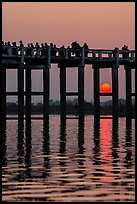 Sun setting behind U Bein Bridge. Amarapura, Myanmar ( color)